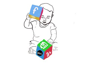 Baby playing with blocks with media logos.